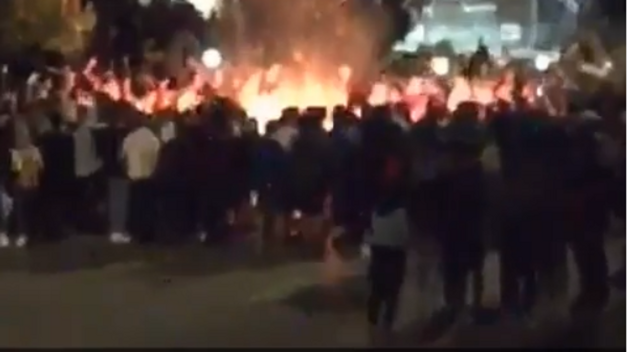Ontario University Students Were Filmed Jumping Through A Huge Fire This Weekend (VIDEOS)