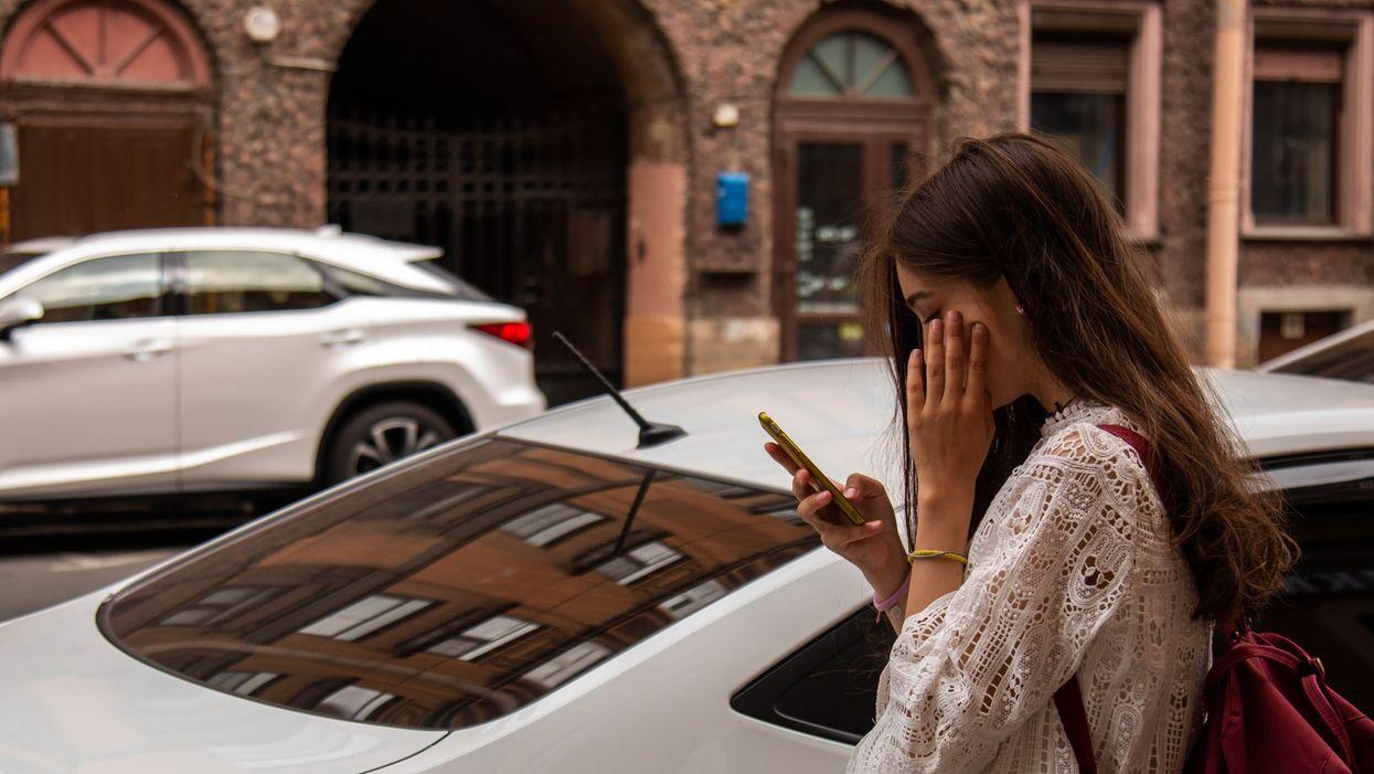 Girl on cell with car, 01680-BUK NarTO