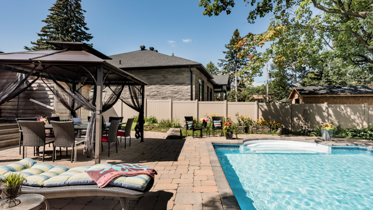 This Ottawa Airbnb Is Like A Private Resort With A Pool & Putting Green In The Back Yard