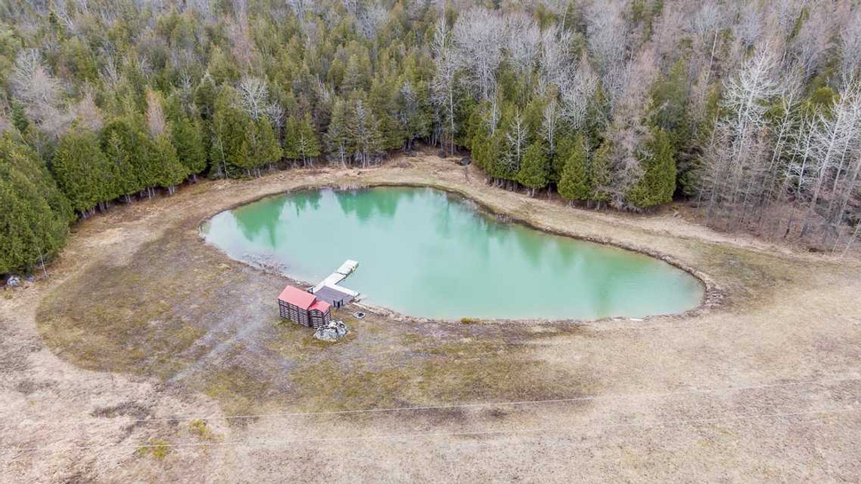 Ontario Home For Sale Comes With Its Own Turquoise Swimming Hole