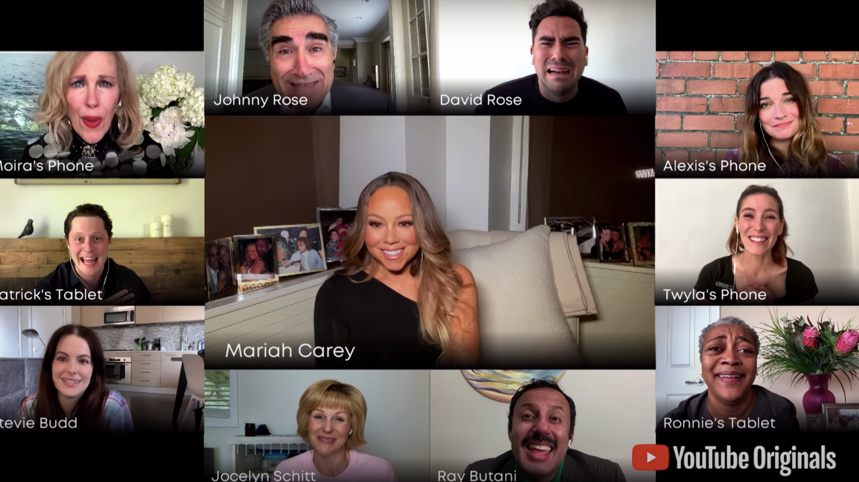 """She'll always be their baby! TheSchitt's Creekcast joined together to give a virtual commencement to the graduating class of 2020. They received a surprising treat while playing their iconic characters when fan fave Mariah Carey joined in on their performance of her song """"Hero""""."""