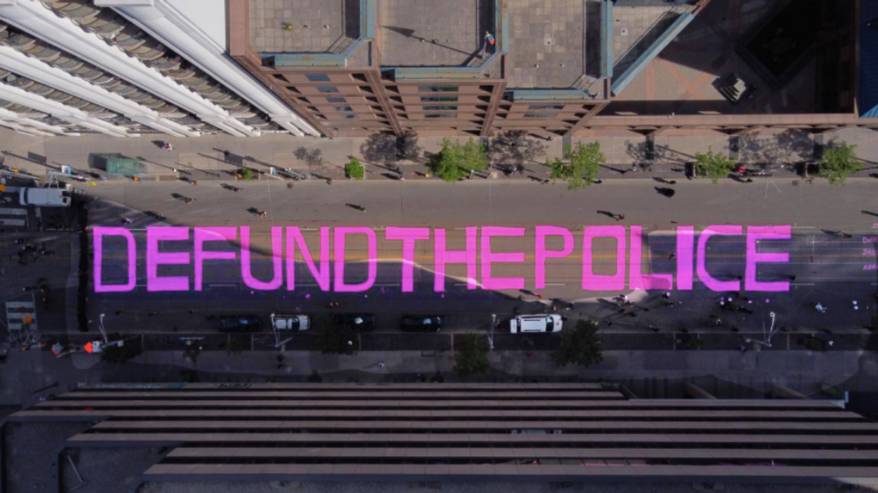 Juneteenth Protestors In Toronto Are Painting 'Defund The Police' On City Streets (VIDEO)