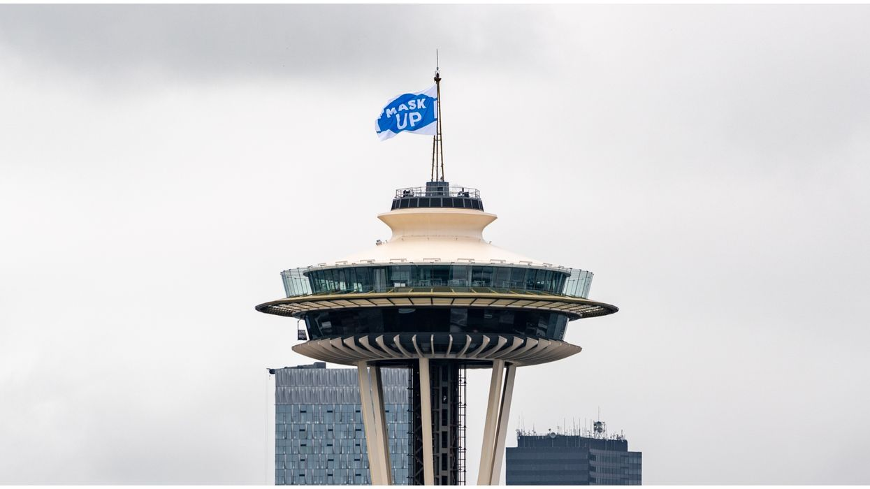 The Seattle Space Needle Raises A Flag To Remind People To Wear Face Coverings