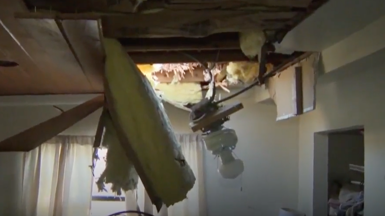 The Canadian Air Force Somehow Managed To Drop A Raft From The Sky Through Somebody's Roof