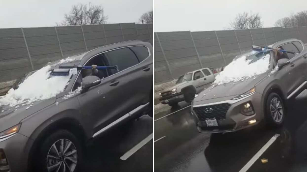 Toronto Driver Caught Trying To Clean Snow Off Her Windshield On The Highway (VIDEO)
