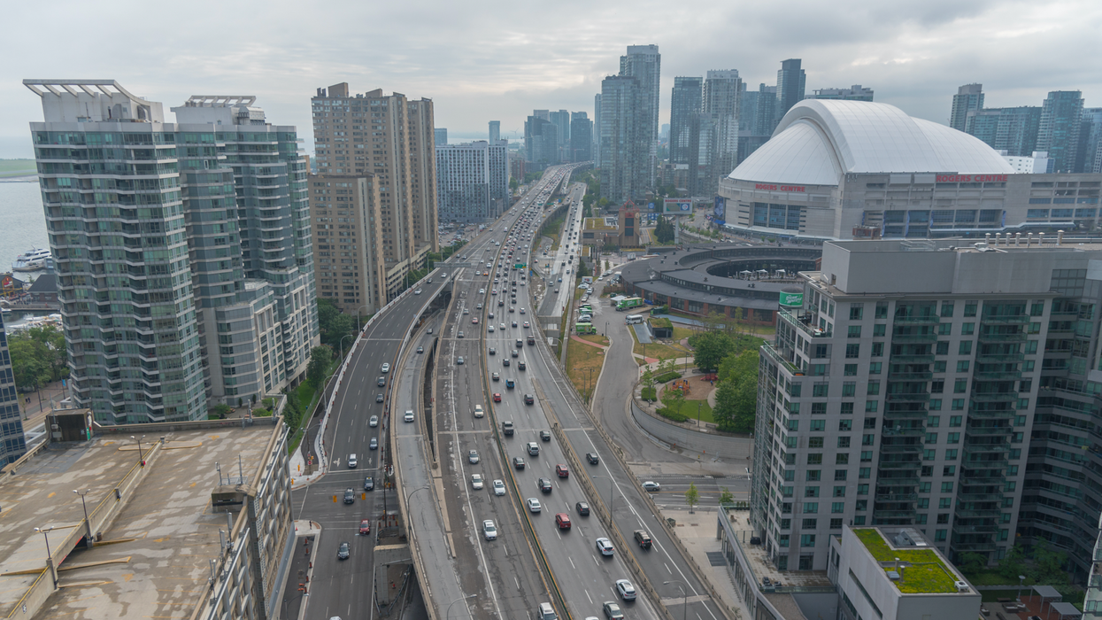 A Massive Lineup Of Dump Trucks Is Halting Highway Traffic In Toronto Right Now (VIDEOS)