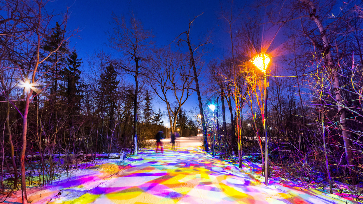 Alberta's Rainbow-Lit Skating Trail Through The Trees Is The Cutest Winter Date Idea