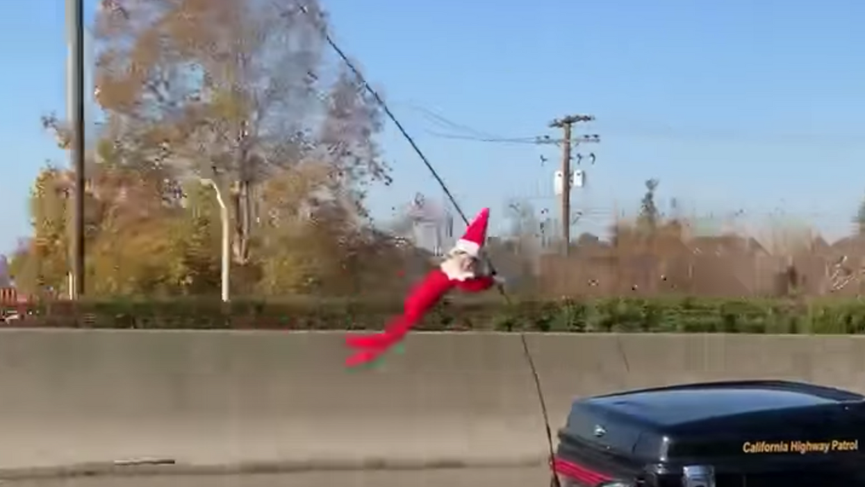 Elf On A Shelf Seen Clinging To California Cop's Motorcycle Like A Small Criminal (VIDEO)
