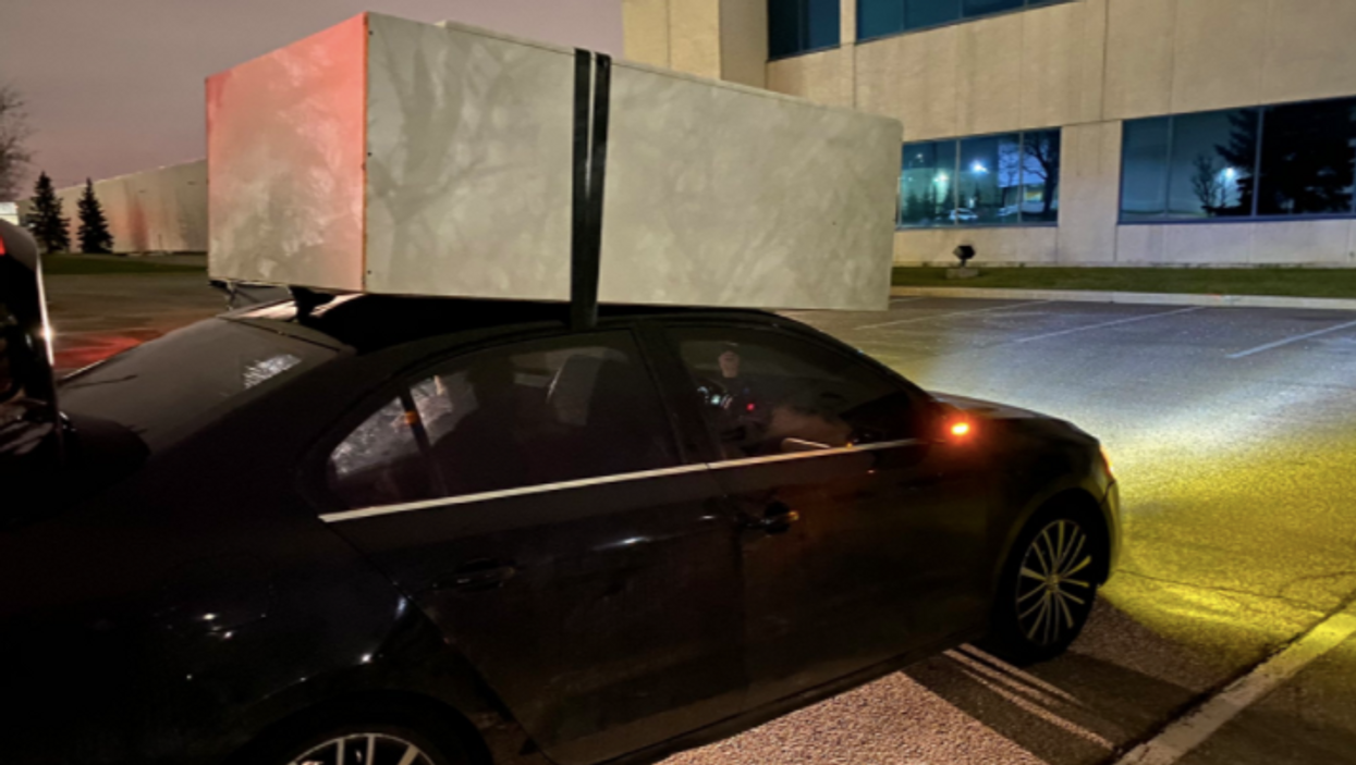 Peel Police Just Caught Someone Driving With A Dresser Taped To The Top Of Their Car