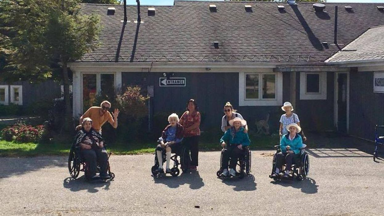 Photo of senior residents with their caregivers