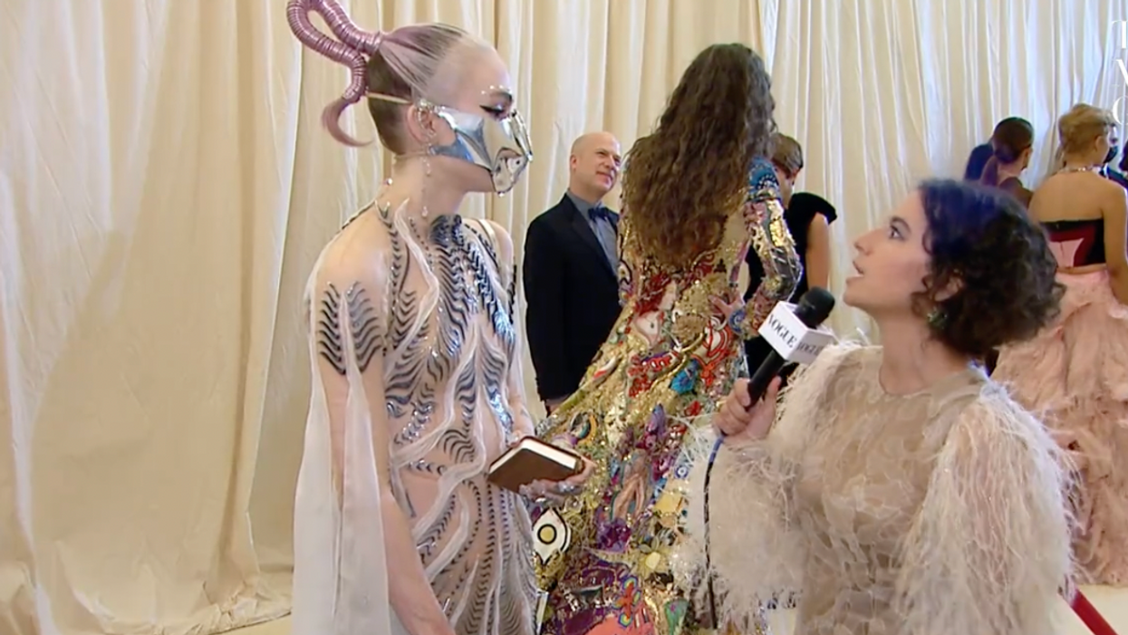 Grimes' Chaotic Met Gala Outfit Involved A Sword & A Metallic Face Mask